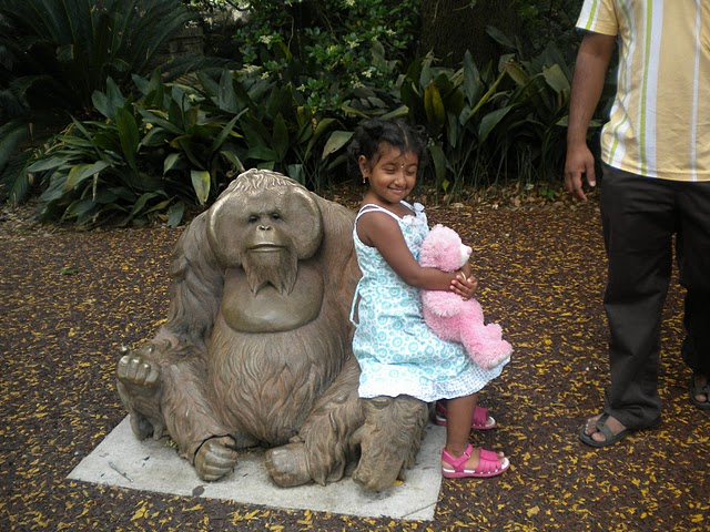 Nivedhana sitting on the Monkey Statue